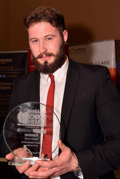 Joe Holden receiving his late father Barry Holden's award