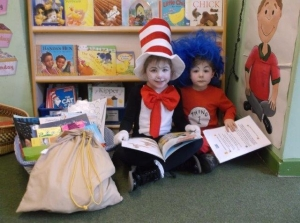 Siblings Alex and Grace with Golden Book Bag