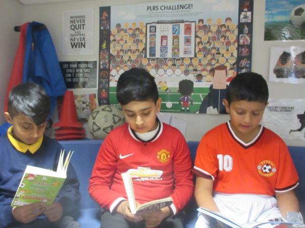 Boys reading PLRS 2