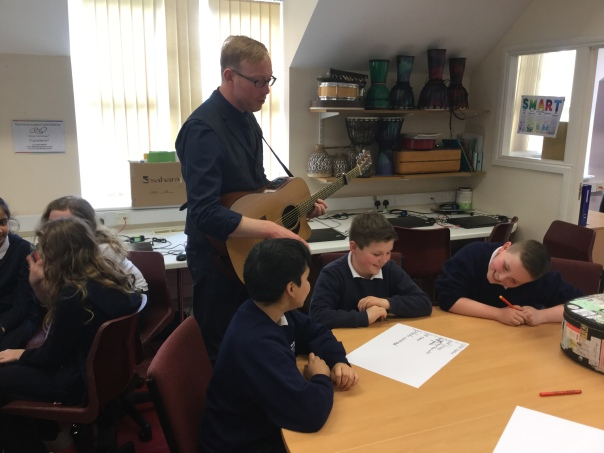 Roger Davies working with pupils at Keelham Primary School